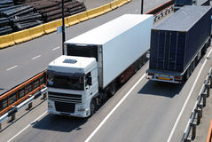 Transportation of cargoes by lorry. Transportation of cargoes in containers by lorry Royalty Free Stock Photos