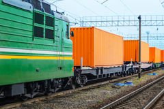 Transportation of cargoes by rail in containers Stock Photos