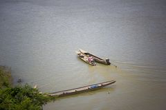 Transportation in Champasak, Laos. Champasak lies 25 miles downstream from the southern hub of Pakse. It`s on the shore opposite the highway, accessible by boat Royalty Free Stock Photography