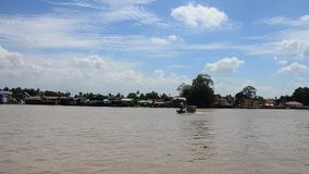 Transportation on Chao Phraya River at Nonthaburi Thailand. The Chao Phraya  is a major river in Thailand, with its low alluvial plain forming the centre of the stock video