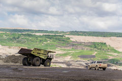 Transportation in Coal Mining. Big foot Transportation in Coal Mining Royalty Free Stock Images