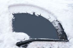 Transportation concept. Car's window has been cleaned from snow by wipers in the winter day. Stock Photography