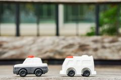 Transportation concept - cute police car and ambulance van toy model for kid Stock Images