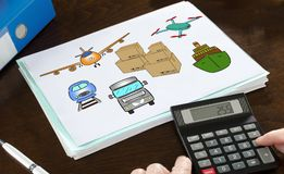 Transportation concept illustrated on a paper. With a calculator Stock Image