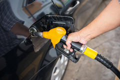 transportation concept - man pumping fuel Royalty Free Stock Photography