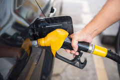Transportation concept - man pumping fuel Royalty Free Stock Photos