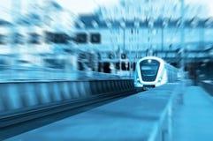 Transportation conceptual image. A speeding train on rails. Motion blur picture Stock Images
