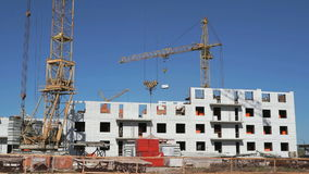 Transportation of the concrete slab using a crane. The construction of the high-rise residential building. Transportation of the concrete slab using construction stock footage