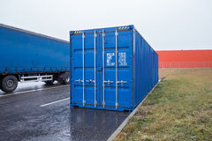Transportation container and truck on parking Stock Image