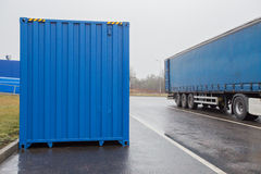 Transportation container and truck on parking Stock Photography