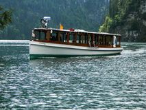 Transportation on the emerald Konigsee Lake. Stock Images