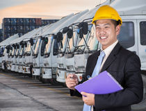 Transportation engineer. With trucks of a transporting company in a row Royalty Free Stock Photography