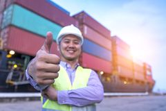 Transportation engineer working at port,. Show thumbs up for good job with container import and export background, World wide logistic, The cargo ship, Shipment stock images
