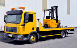 Transportation of a forklift truck Royalty Free Stock Images