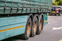 Transportation, freight transport and dirty diesel at city concept - close up of truck on street royalty free stock image
