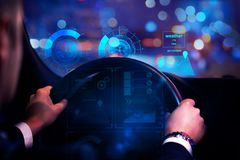 Transportation and future concept. Close up of businessman hands driving car with abstract glowing digital interface. Transportation and future concept. 3D royalty free stock images