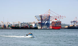 Transportation of goods. Transportation of big containers  via sea motorships Royalty Free Stock Photos
