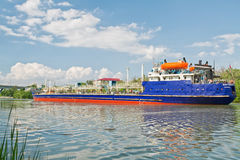 Transportation of goods and petroleum products on barges on the Stock Photo