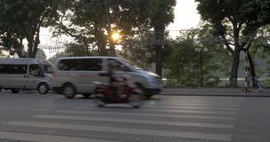 Transportation in Hanoi, Vietnam. HANOI, VIETNAM - OCTOBER 27, 2015: City traffic on highway at sunset and sidewalk with pedestrians. Hanoi is called the city of stock video