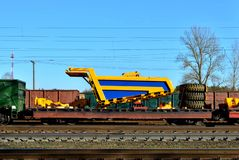 Transportation heavy mining dump truck by rail. Yellow mining truck disassembled into parts, cab, body, electric motor,. Logistics transportation heavy mining stock image