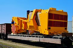 Transportation heavy mining dump truck by rail. Yellow mining truck disassembled into parts, cab, body, electric motor,. Logistics transportation heavy mining stock photo