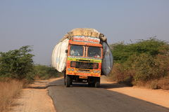 Transportation in India. Commercial goods in India are often moved in dangerous and unregulated ways - such as this grossly overloaded lorry Stock Photos
