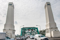 Transportation on iron bridge. Everyday Life, temple, River Royalty Free Stock Photos