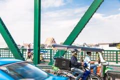 Transportation on iron bridge. Everyday Life Stock Photo