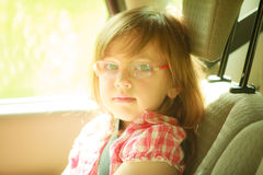 Transportation. Little girl child kid sitting in the car Royalty Free Stock Photos