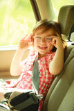 Transportation. Little girl child kid sitting in the car Royalty Free Stock Image