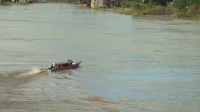 Transportation,  ferry , mekong , cambodia. Southeast asia – Cambodia - Kampong Cham.  People in  local ferry boat  crossing  Mekong river in the morning stock video