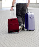 Transportation of luggage. In the form of bags on wheels Stock Photos