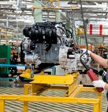 Transportation of the new car engine. Valve on a car repair factory Stock Photo
