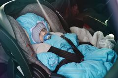 Transportation of newborn in car Royalty Free Stock Photography