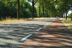 Transportation in Netherlands, roads with bicycle paths and whit stock images