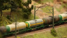 Transportation Oil by Railway. Miniature railroad tank car with oil and gasoline stock footage