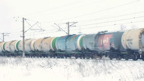 Transportation of oil in tank. Wagons on winter railroad stock footage