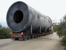 Transportation of oversized cargo. Industrial rotary tube furnace Stock Image