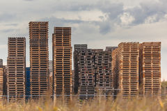 Transportation Pallets at a Warehouse. Stacks of used Wooden Euro Pallets at a Recycling Depot Royalty Free Stock Photography