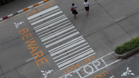 Transportation pedestrians and vehicles crossing on crosswalk during evening day, top angle view or bird eyes shot. Transportation pedestrians and vehicles stock footage