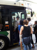 Transportation-People boarding a Bus. Transportation-People boarding a Mass Transportation Public Bus Royalty Free Stock Image