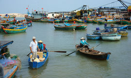 Transportation people and goods by wooden boat at habor Stock Images