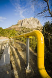 Transportation by pipe. Transportation something by yellow pipe Stock Images