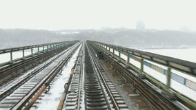 Transportation by rail. Movement of trains on winter bridge. View from the driver's cab stock video footage