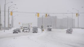 Transportation scenes during a snowfall in Toronto stock video footage