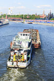 Transportation of scrap metal on a barge on Moscow River. Stock Image