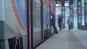 Transportation service industry, people entering suburban electric train. Stock footage stock video