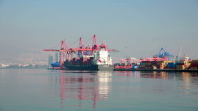 Transportation ship at Harbor. Port, Industrial Container Cargo freight ship with working crane bridge stock video