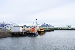 Transportation ship park in Hornafjordur port, a blooming community in the realm of the greatest glacier in southeast Iceland. stock photo