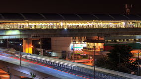 Transportation sky train and mass transit at night. Timelapse stock footage